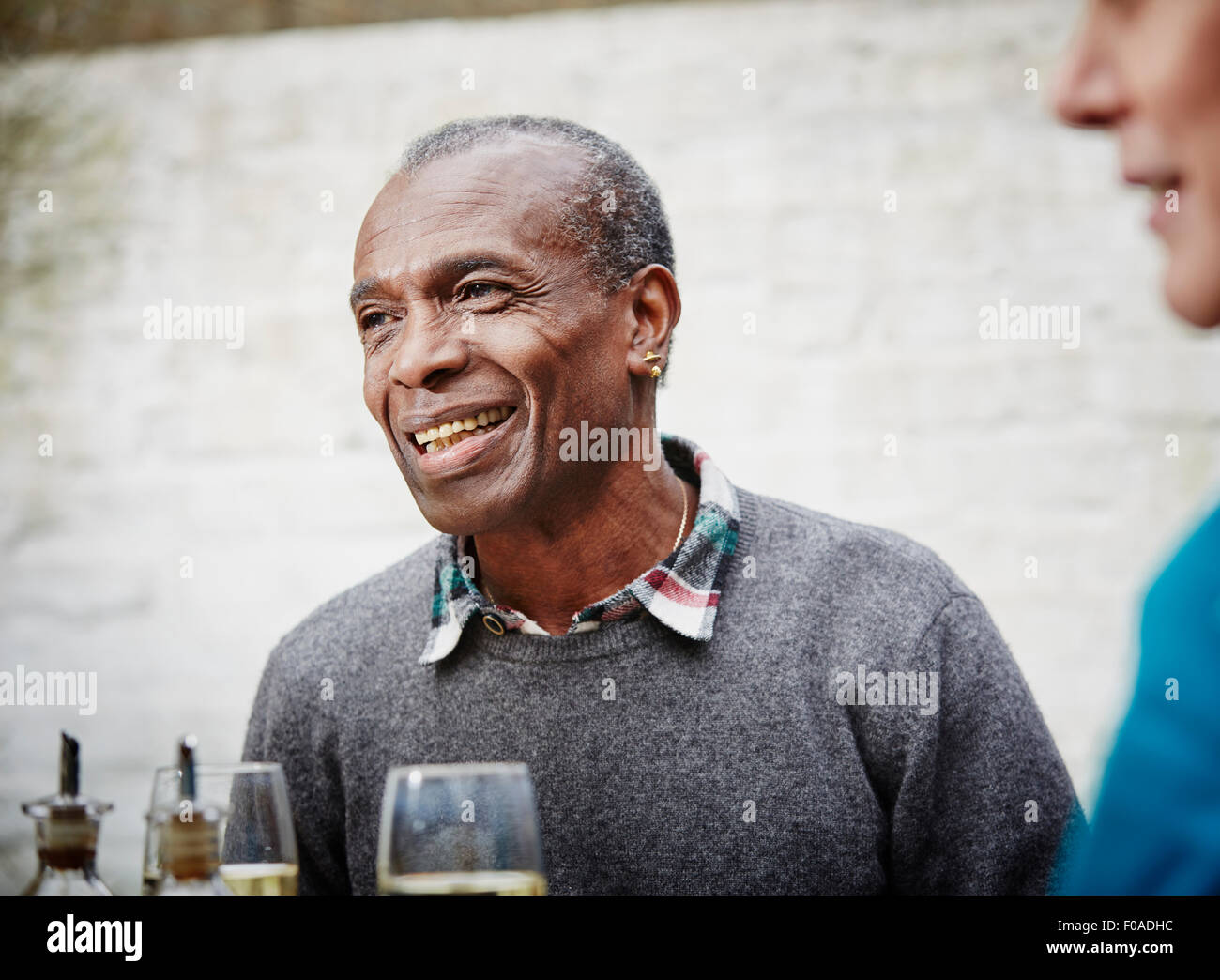 Senior man smiling, portrait - Stock Image
