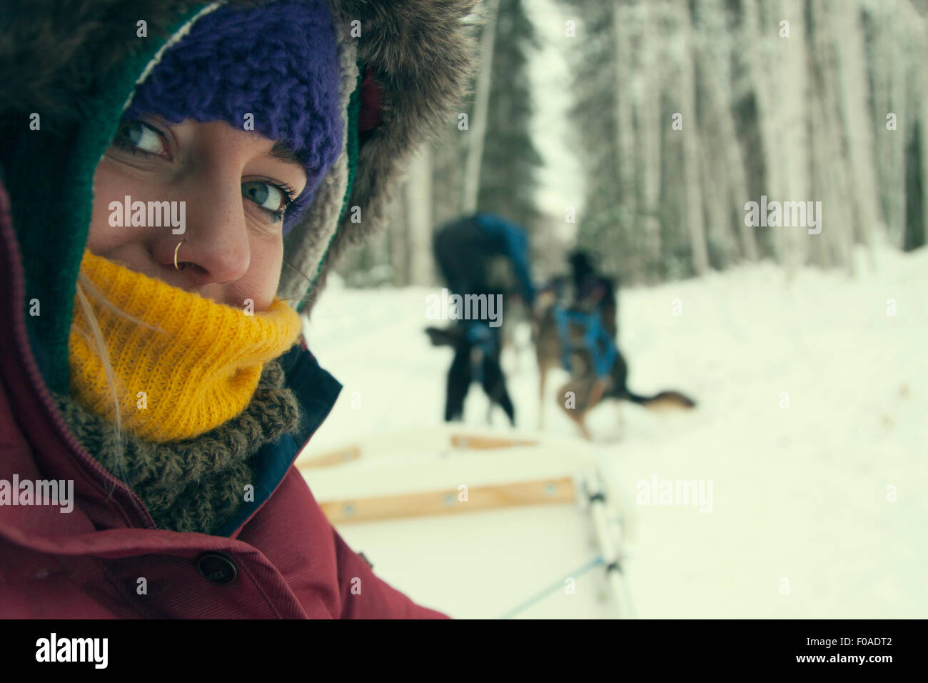 Young woman wearing winter clothing, close up - Stock Image