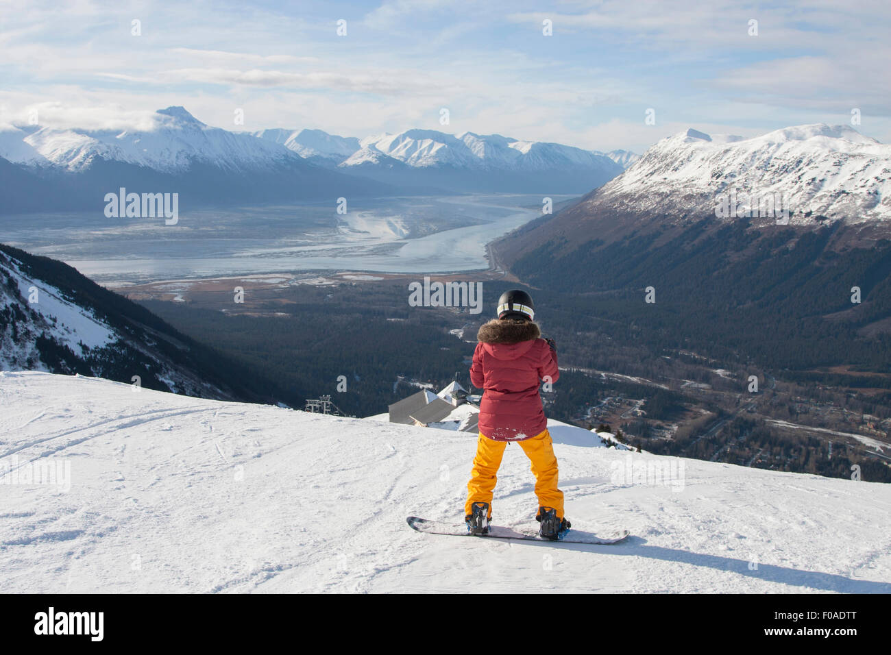 Young woman on snowboard, Girdwood, Anchorage, Alaska - Stock Image