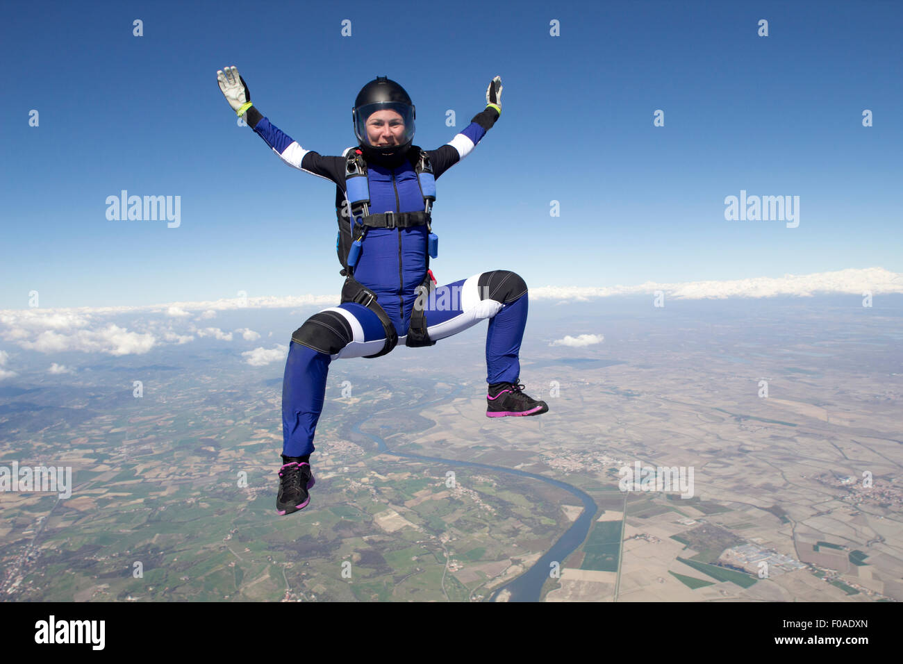Freeflying skydiver in blue sky - Stock Image