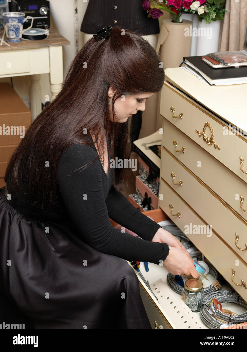 Corset maker storing tools in drawer - Stock Image