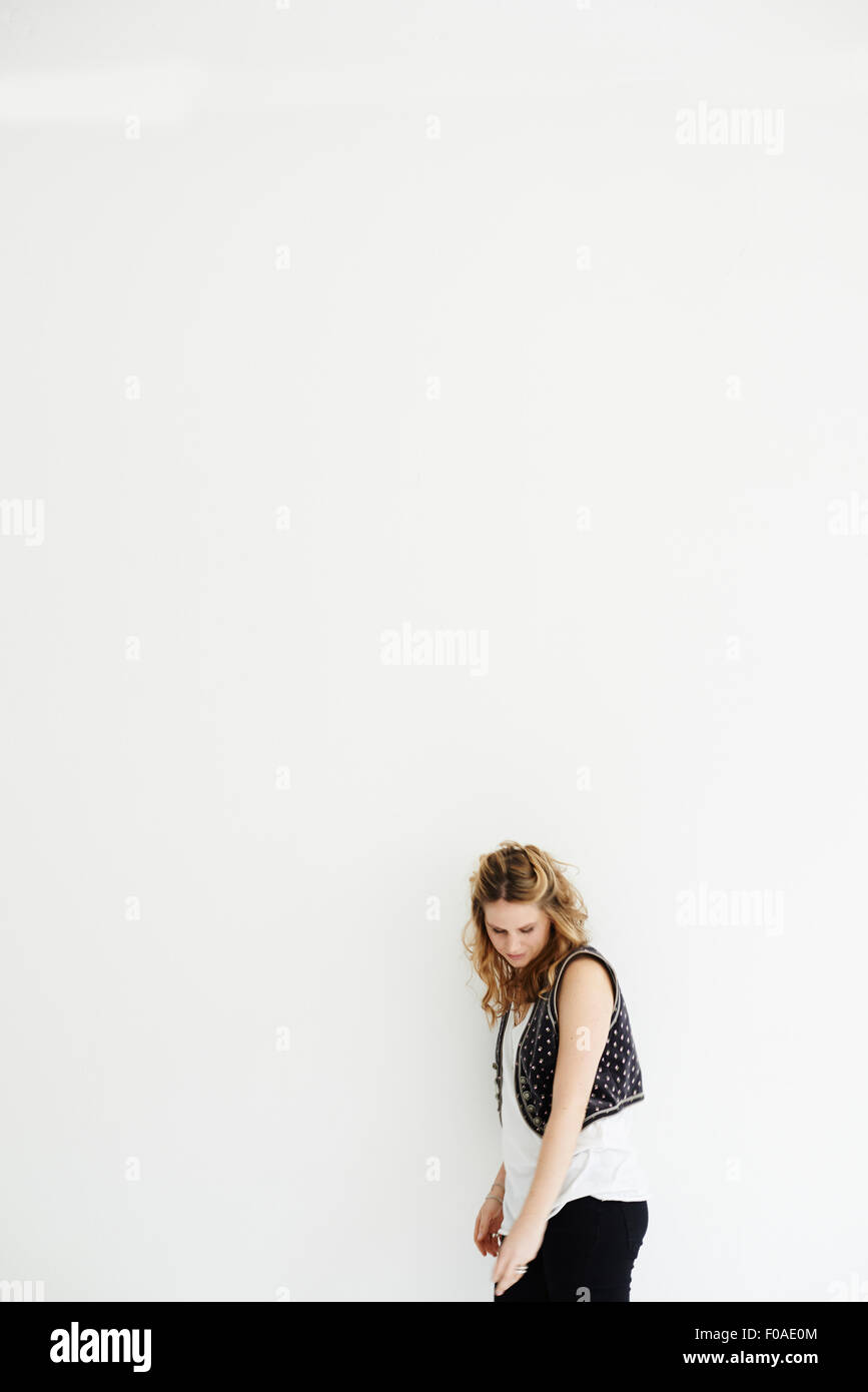 Mid adult woman looking down, copy space - Stock Image
