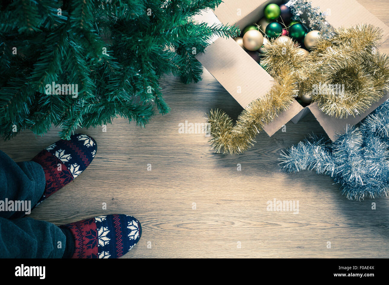 Person wearing slippers with christmas decorations, high angle Stock Photo