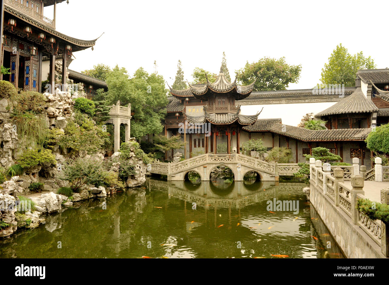 Traditional Chinese garden with fish pool, stone bridge and Stock ...
