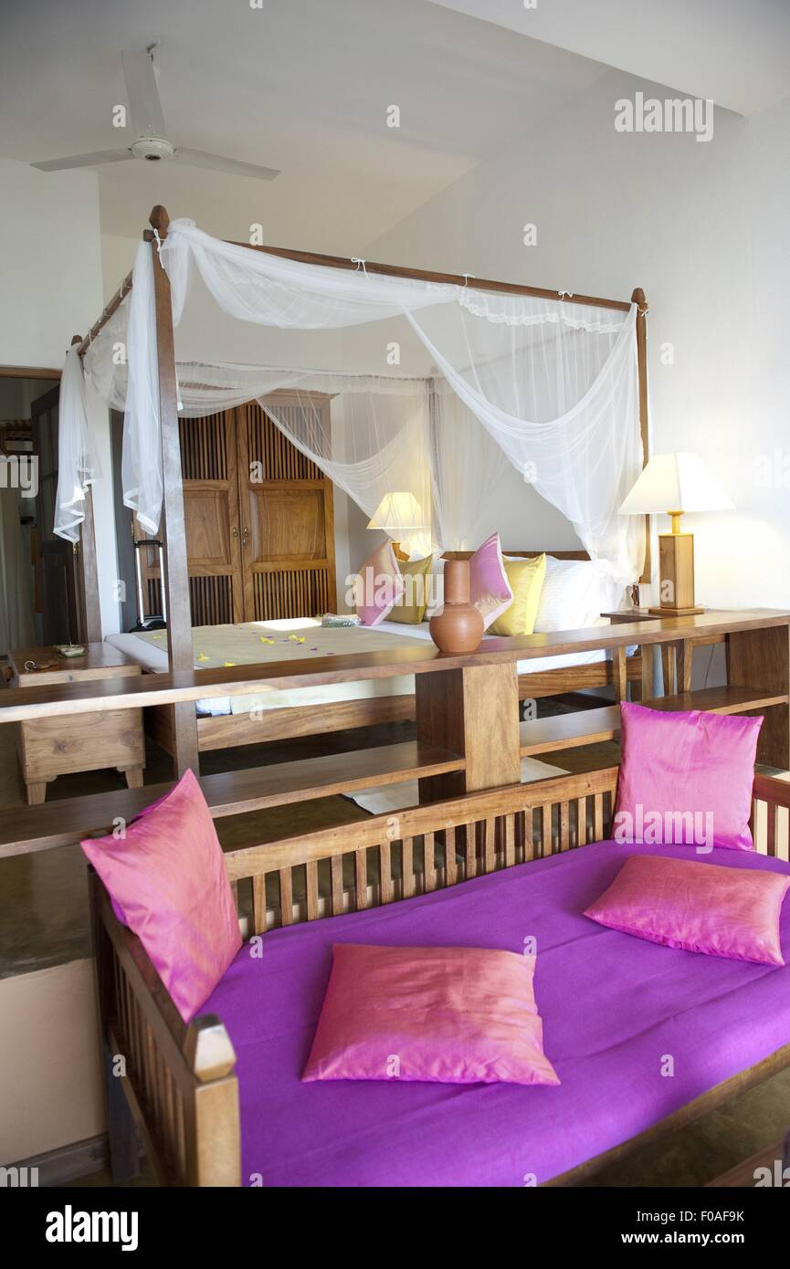 Bedroom with four poster bed in Barberyn Reef Ayurveda Resort, Weligama, Sri Lanka - Stock Image