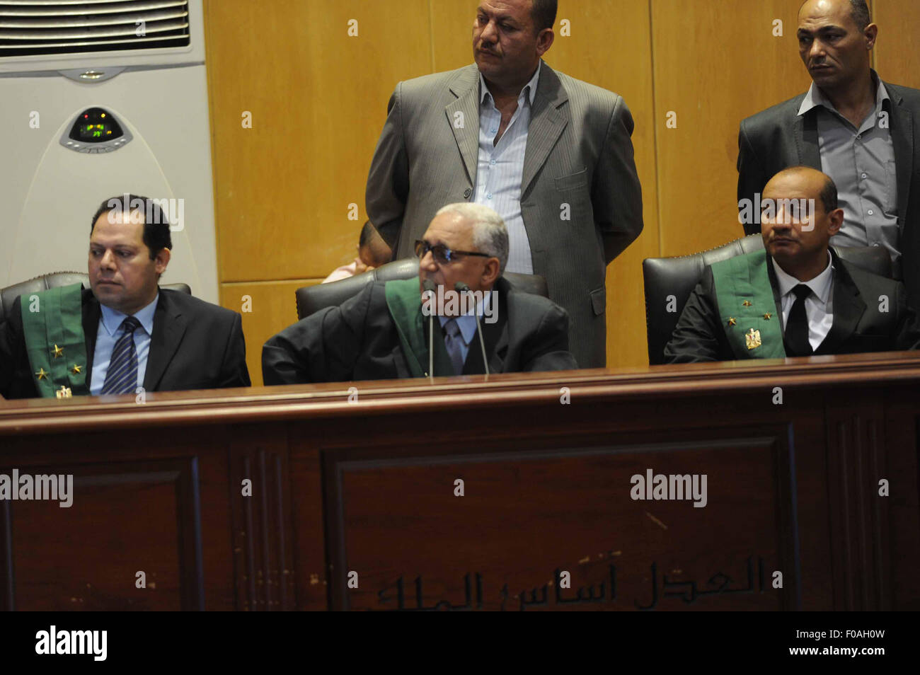 Cairo, Egypt. 11th Aug, 2015. The Judge attend the trial of Egyptian defendants over a 2012 stadium riot in the Stock Photo