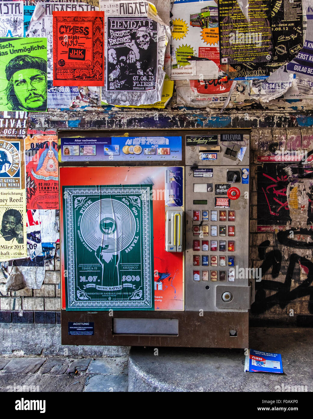 Old cigarette dispensing machine requiring ID cards - Berlin Kreuzberg, Tommy Weissbaecker Haus, Tommy House - Stock Image