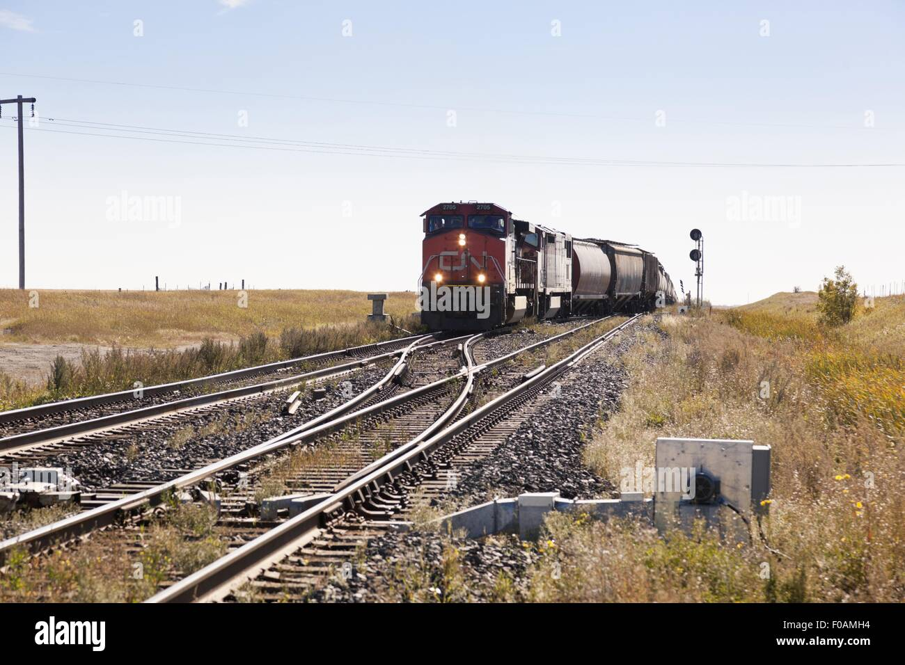 View of train and railway line in Watrous small town, Saskatchewan, Canada - Stock Image
