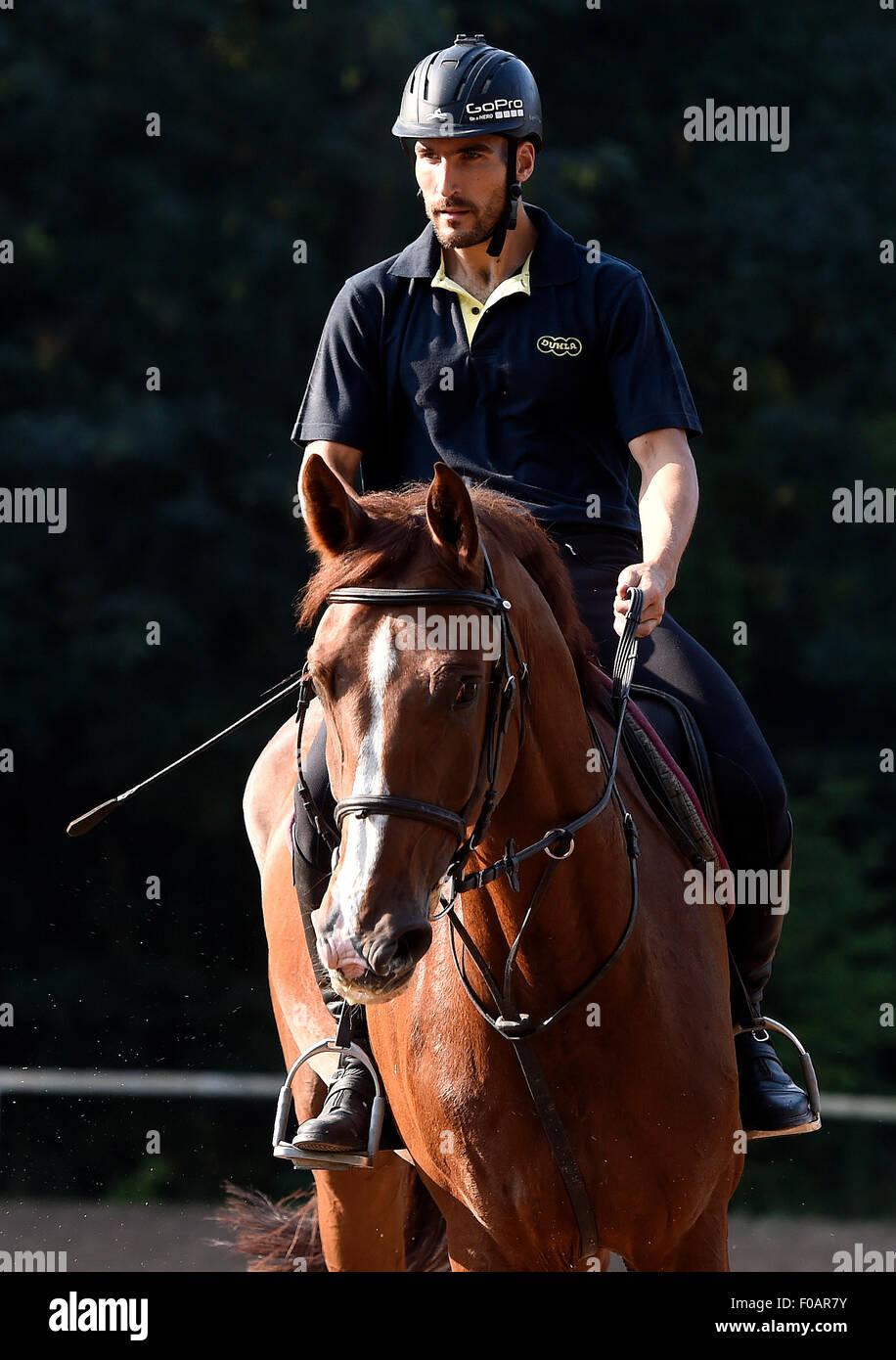 Czech athlete David Svoboda rides a horse at the meeting with Czech representatives of the modern pentathlon prior - Stock Image