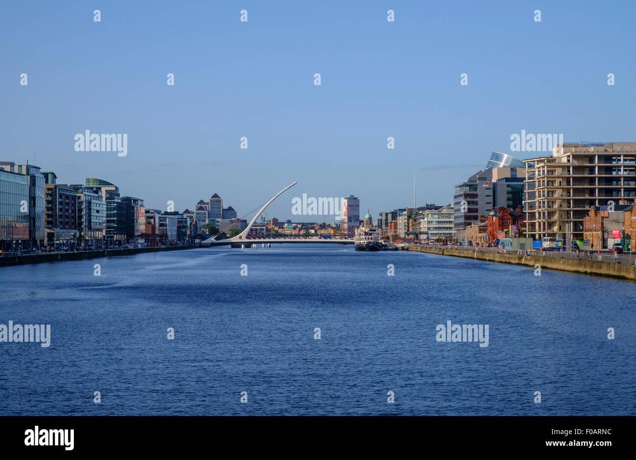 dublin cityscape view river liffey skyline bridge calatrava business district construction quay quays blue sky - Stock Image