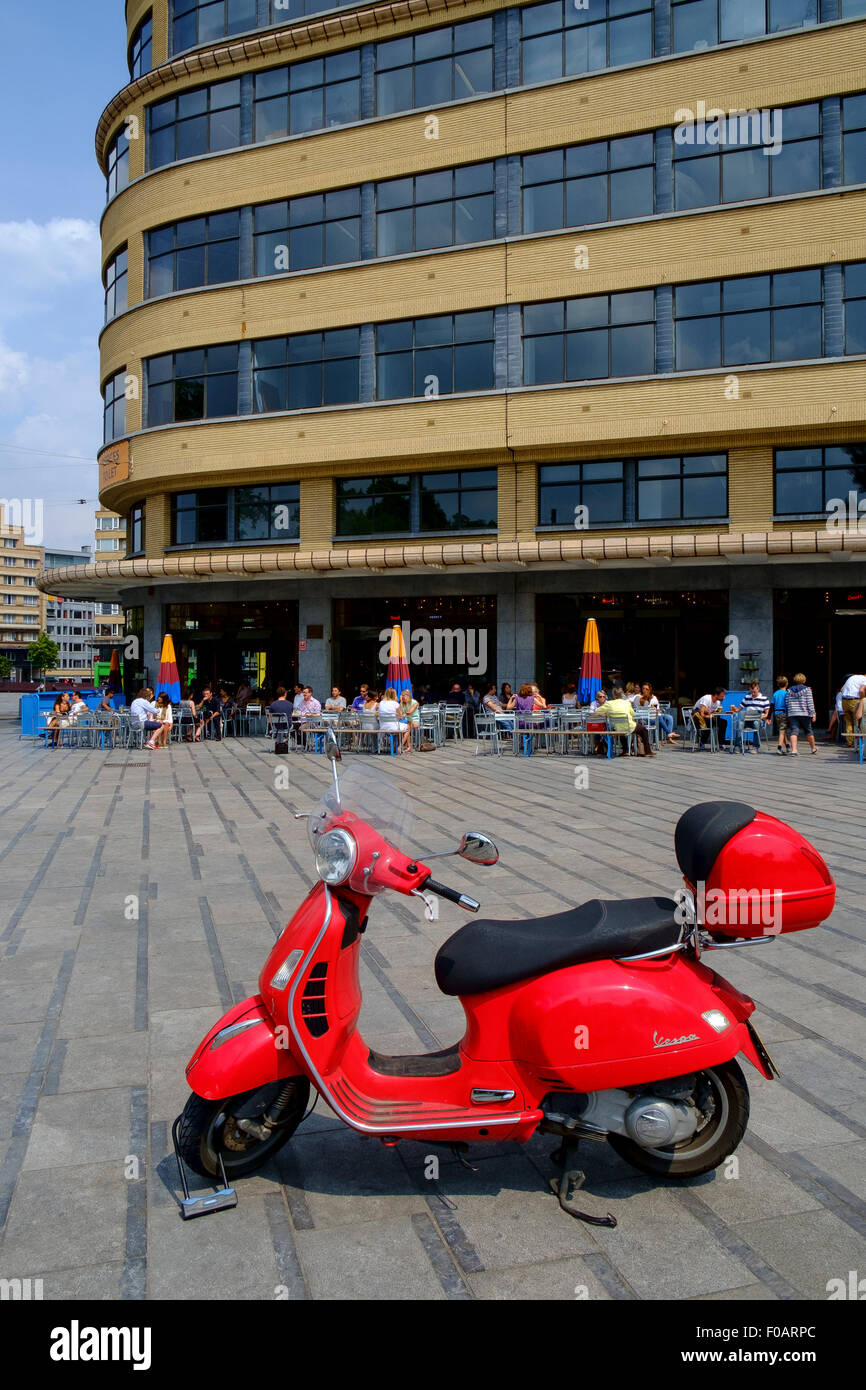 red vespa scooter parked locked lock plaza - Stock Image