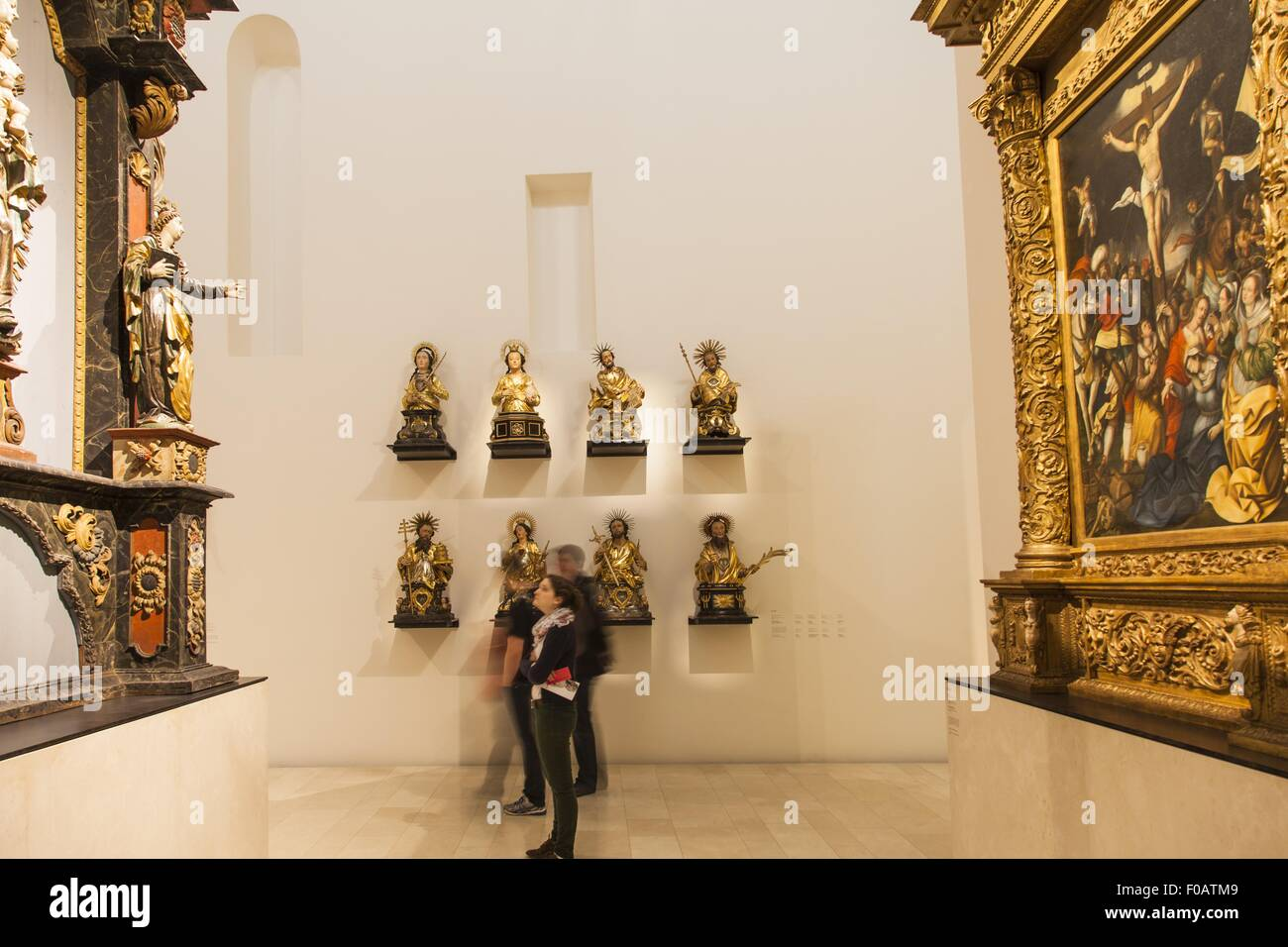 Busts of saints of Freiburg guilds in Augustiner Museum, Freiburg, Germany, blurred motion - Stock Image