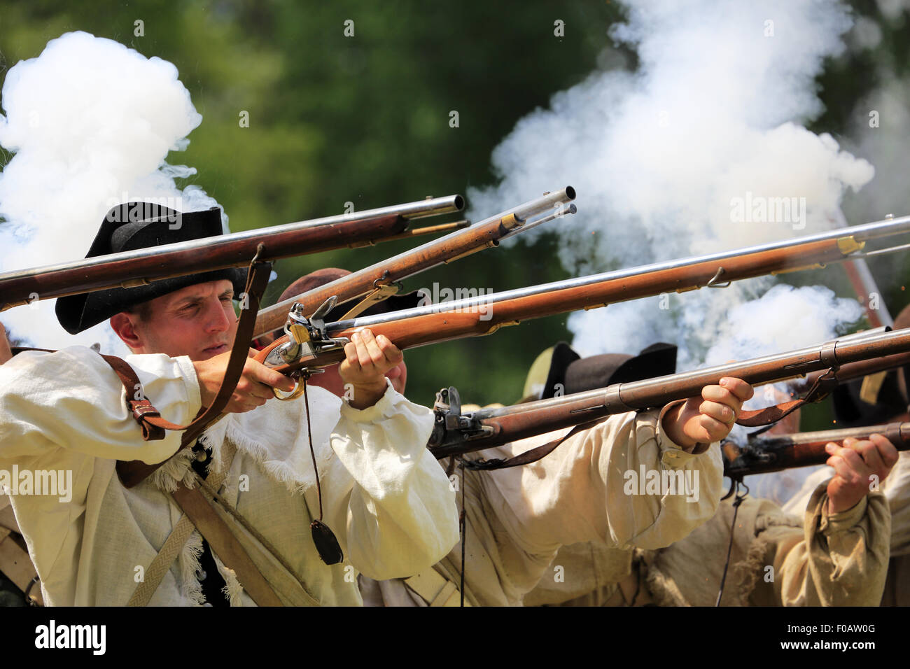 Continental Army soldiers firing muskets during