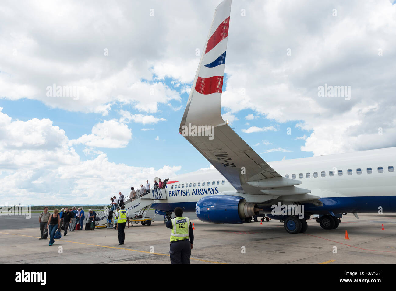 Passengers arriving on British Airways (Comair) Boeing 737-800 at Hosea Kutako International Airport, Windhoek, - Stock Image