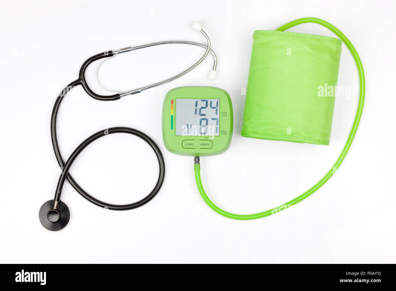 Blood pressure meter and stethoscope isolated on a white background - Stock Image