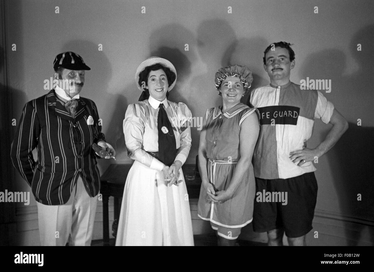 Two couples wearing fancy dress - Stock Image