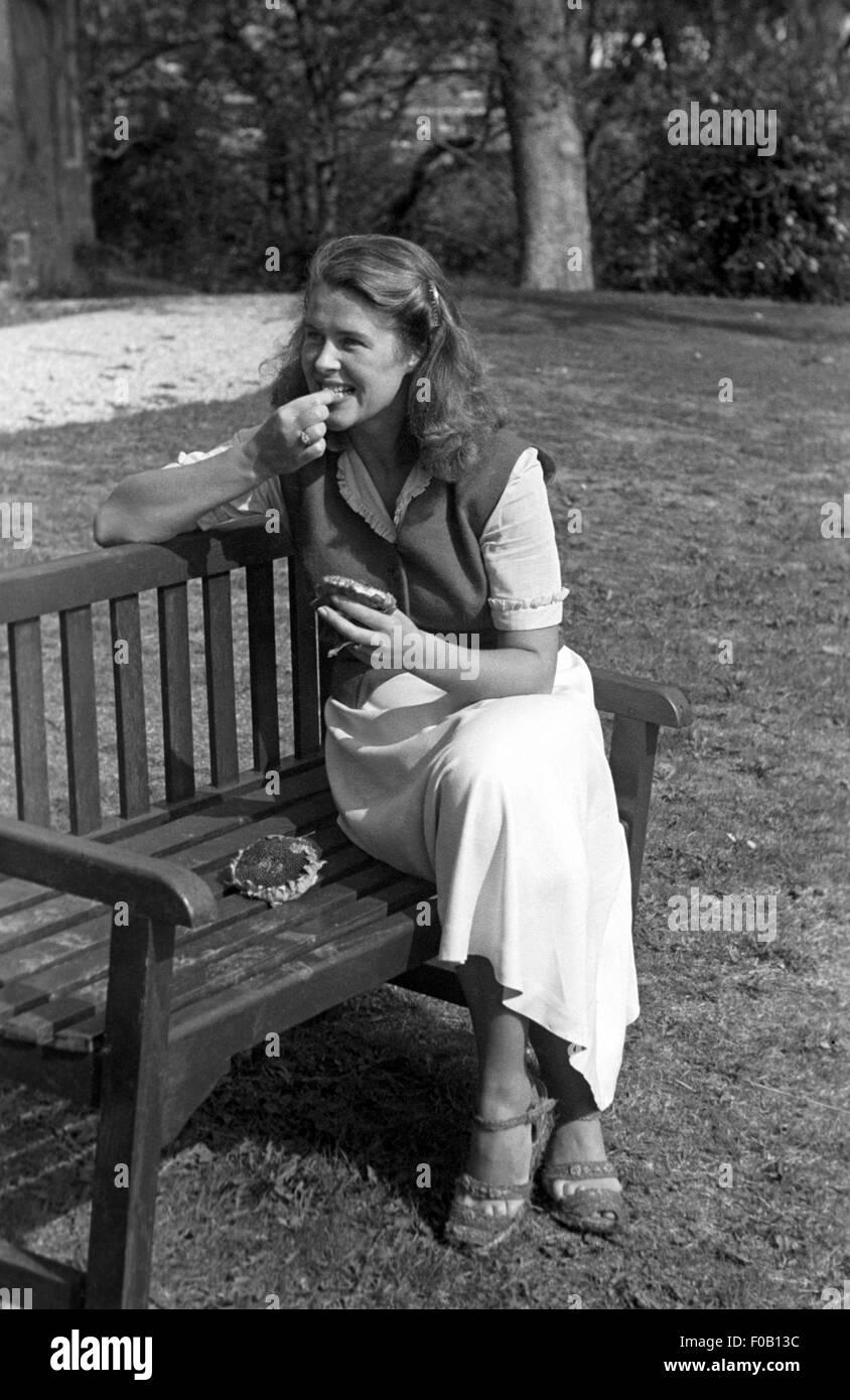 Mature woman sitting on mall bench