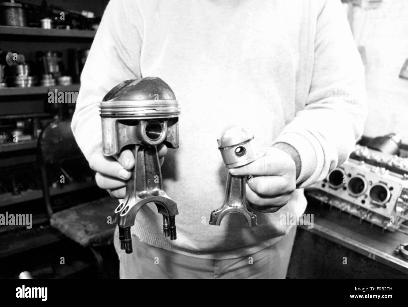 Doug Nye holding BRM P15 and P25 pistons Stock Photo