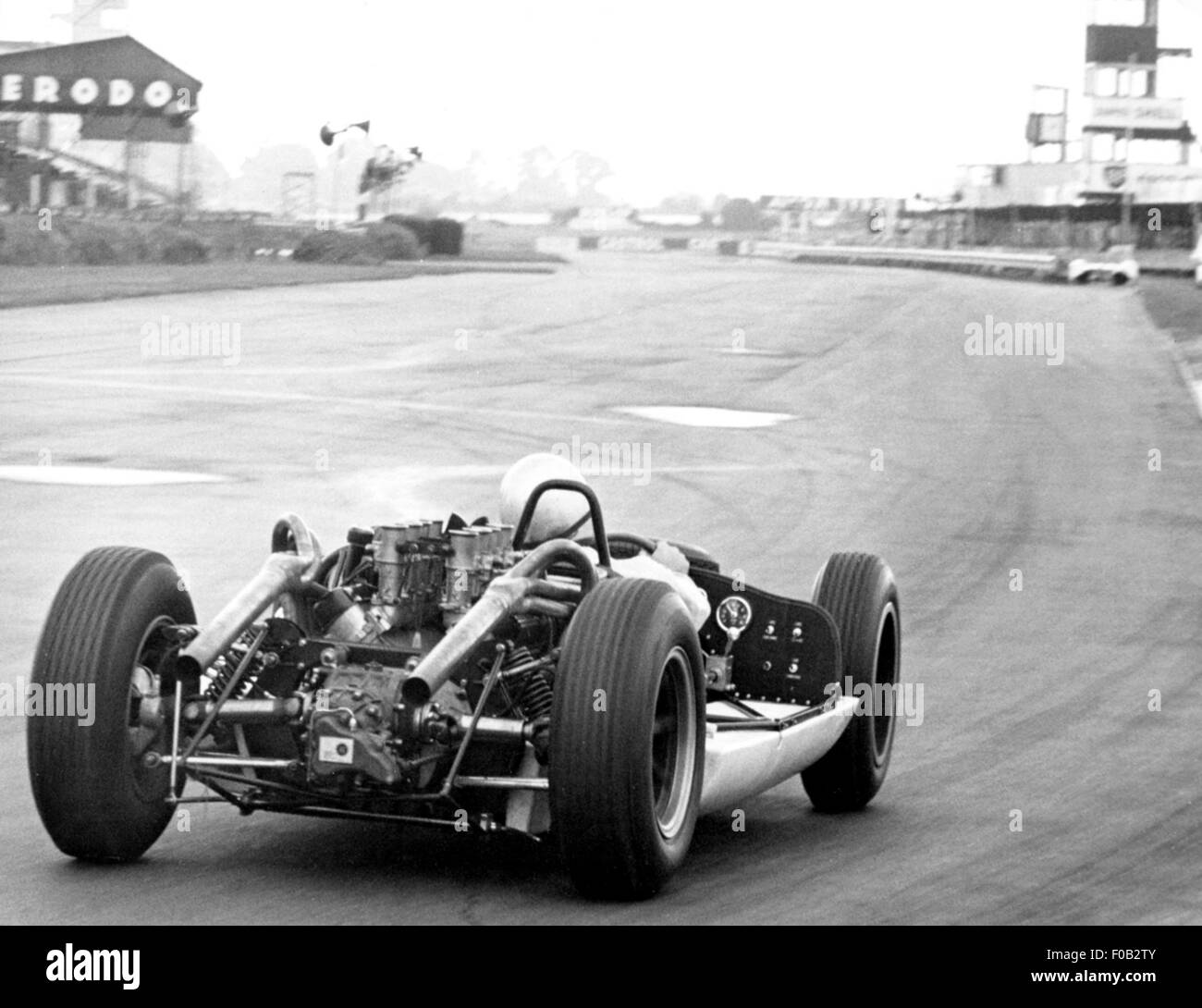Bruce McLaren testing a sports car at Goodwood 1964 - Stock Image
