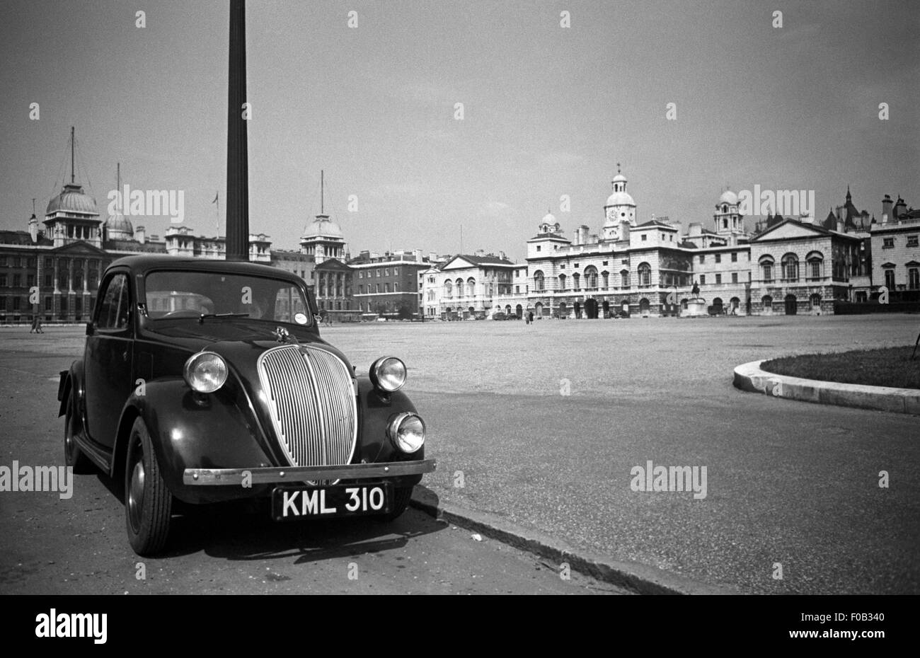 A Topolino Fiat 500 car parked at Horse Guards Parade in London - Stock Image