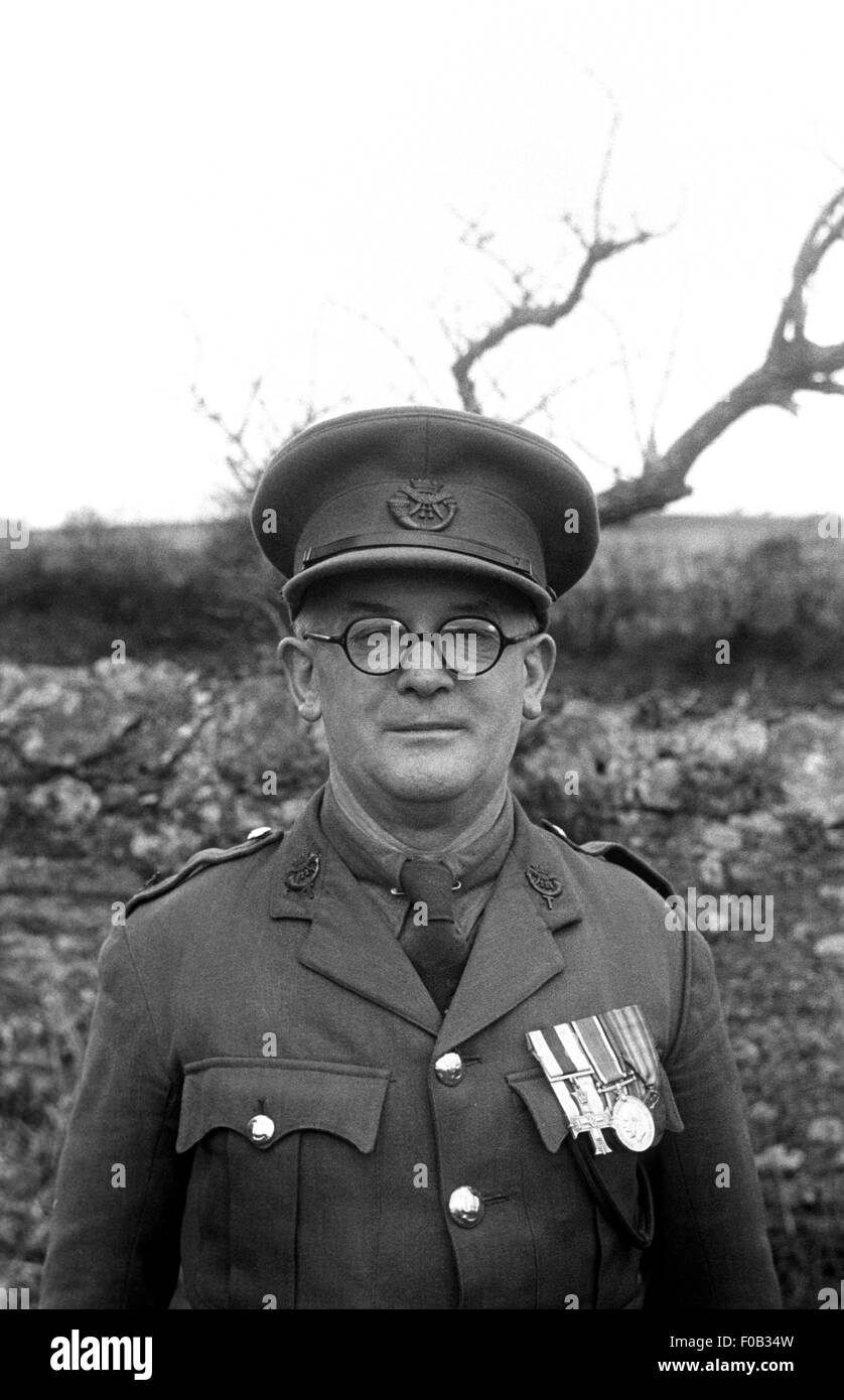 b02523d2f8 A man wearing glasses and his military uniform decorated with medals ...