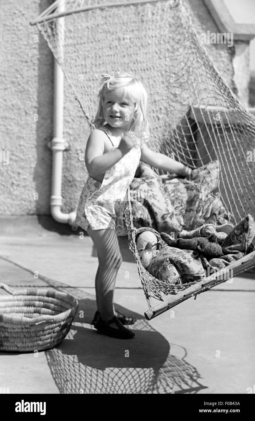 Young child playing with a hammock. - Stock Image