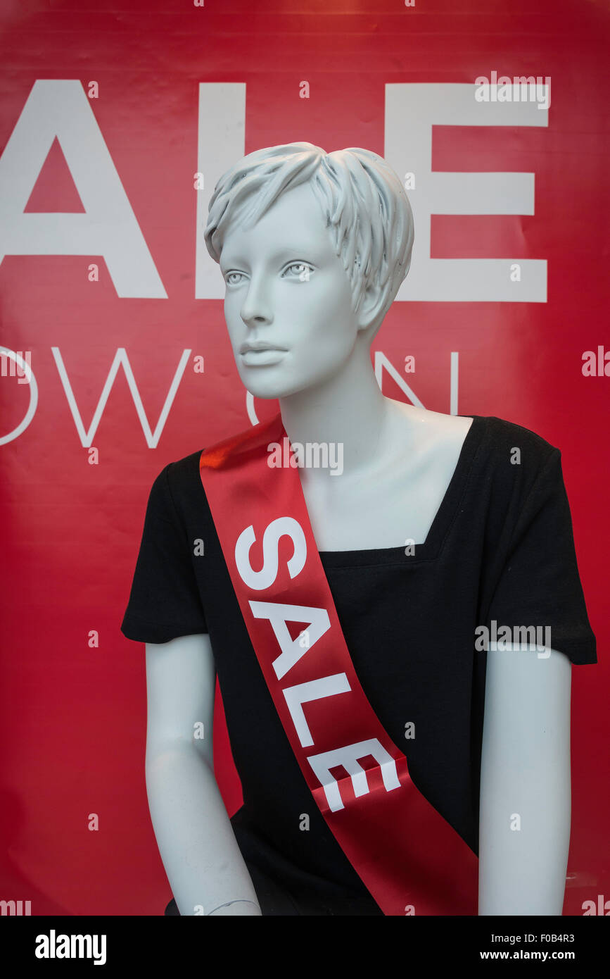 Shop sale window with dummy, High Street, Daventry, Northamptonshire, England, United Kingdom - Stock Image