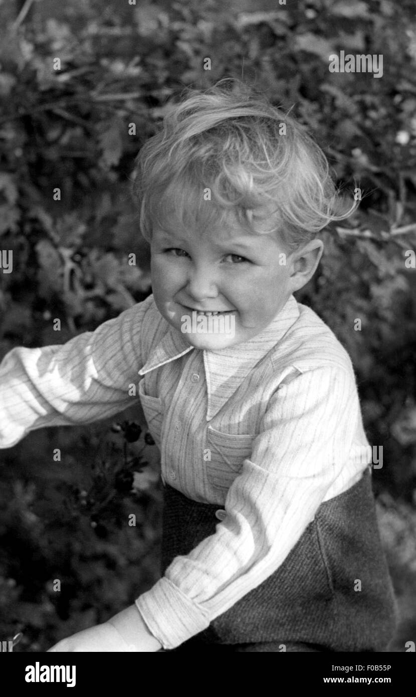 Smiling blonde haired boy. - Stock Image