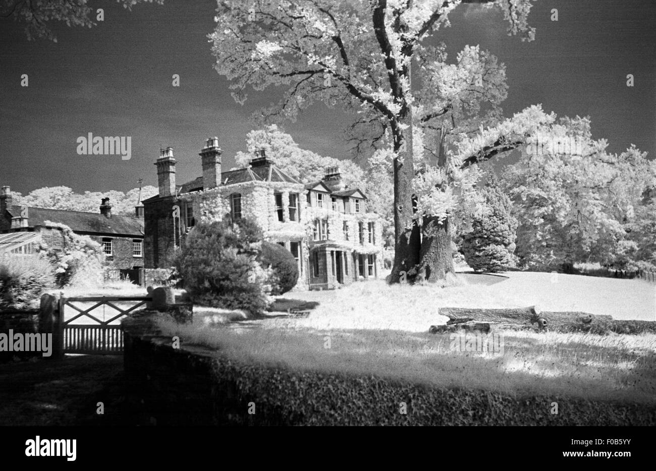 A large country house photographed using infrared film. - Stock Image