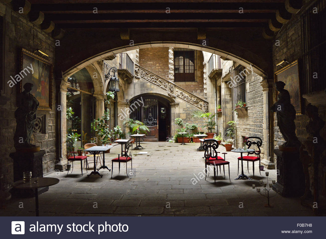 Palau Dalmases Espai Barroc - historic palace restaurant archway entrance, El Born district Barcelona Spain Europe. - Stock Image