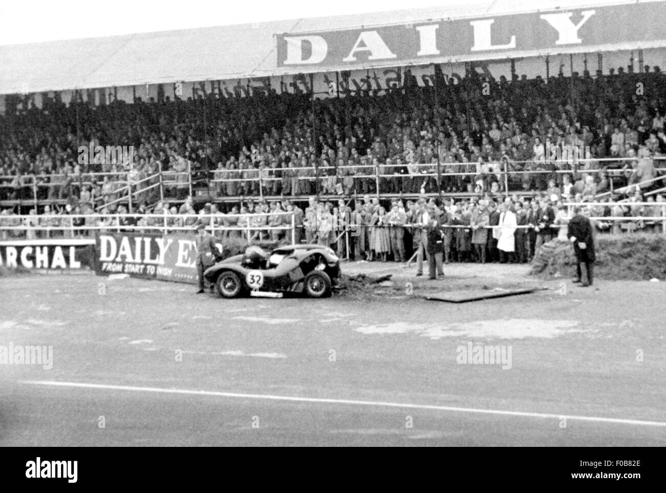 Crashed sports car at Silverstone 1957 - Stock Image