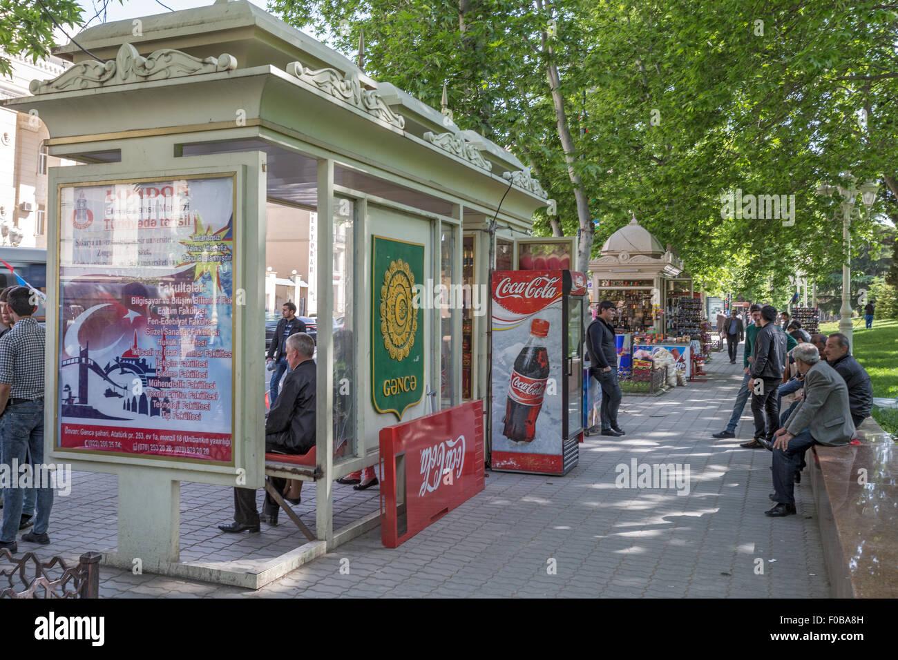 Street view Ganja Azerbaijan. Bus stop & Kiosk - Stock Image