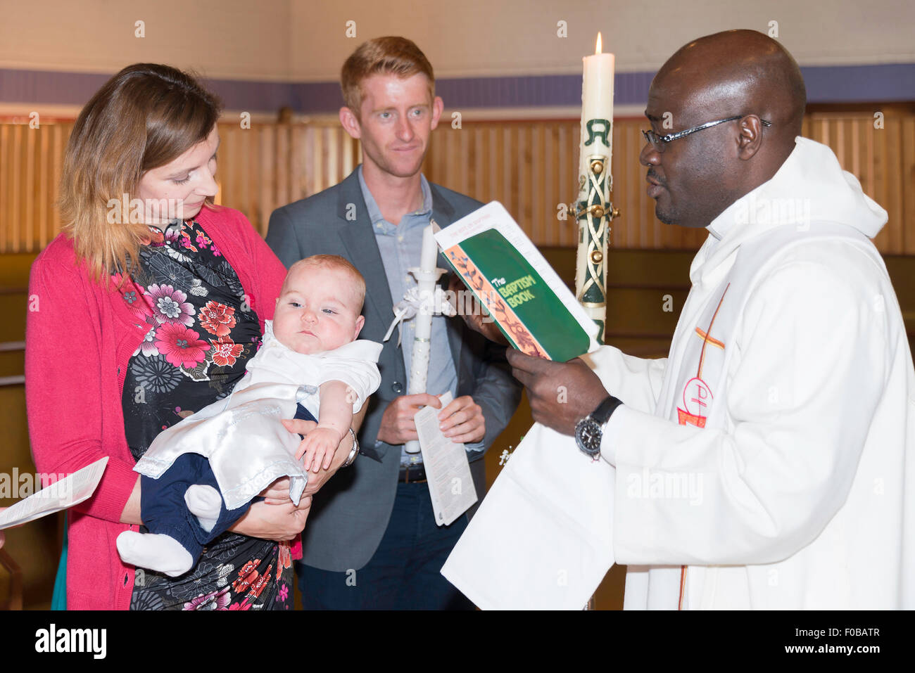 Family christening at St Augustines Roman Catholic Church, Daventry, Northamptonshire, England, United Kingdom - Stock Image