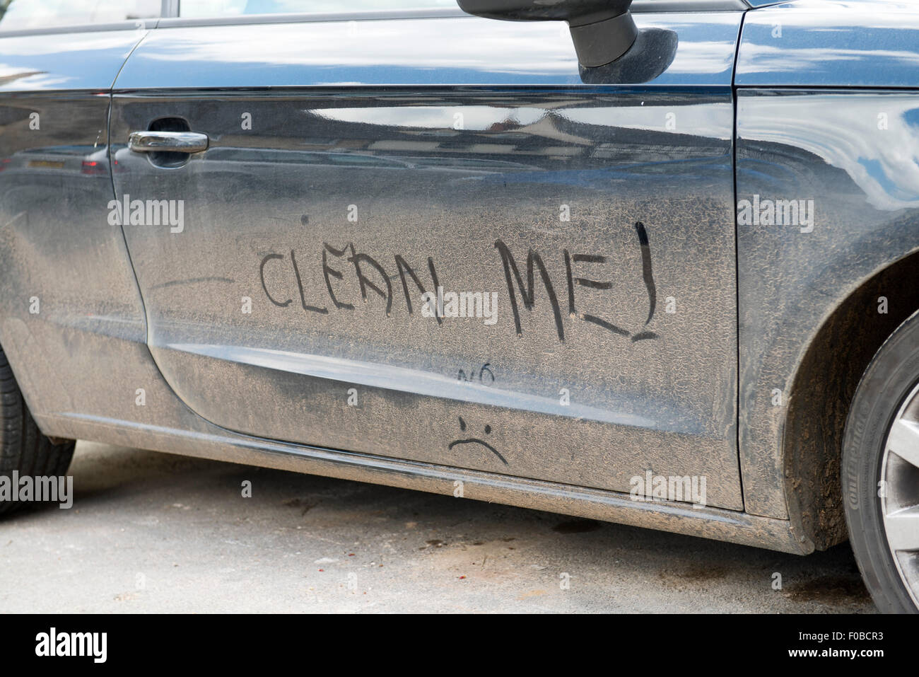 Car Wash Brush >> Clean Me! hand written on dirty car England UK europe Stock Photo: 86303367 - Alamy