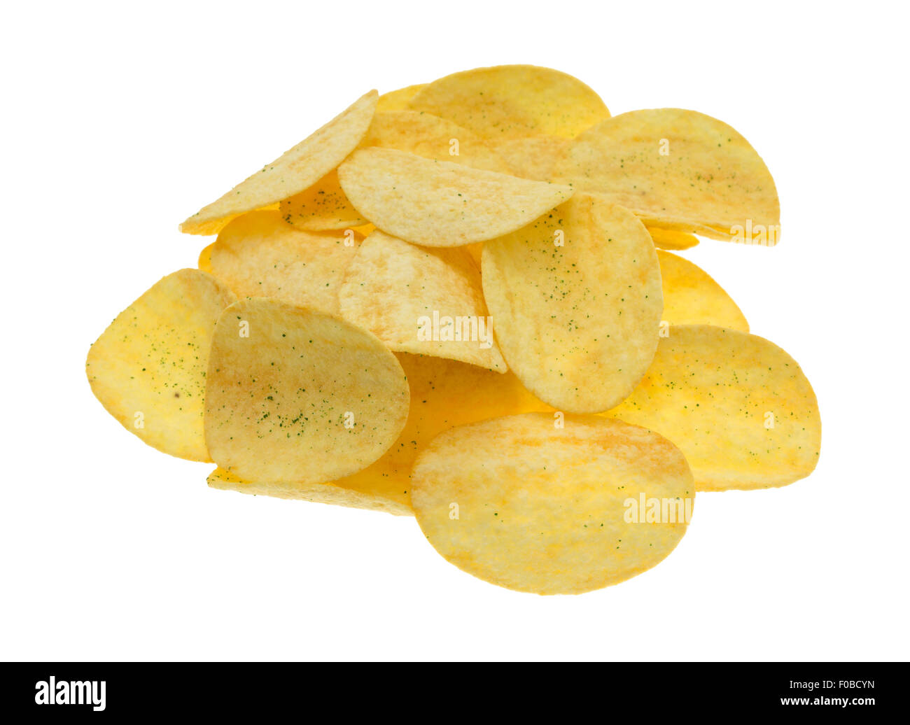 A group of potato chips seasoned with sour cream and chives isolated on a white background. - Stock Image