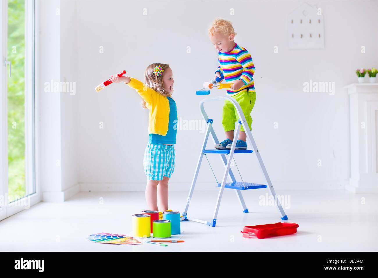Family Remodeling House Home Remodel And Renovation Kids Painting Walls With Colorful Brush Roller