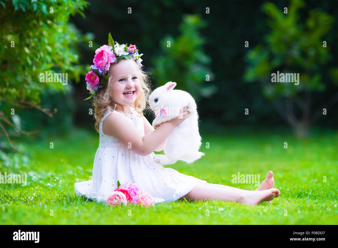 girl  real rabbit child playing  pet bunny