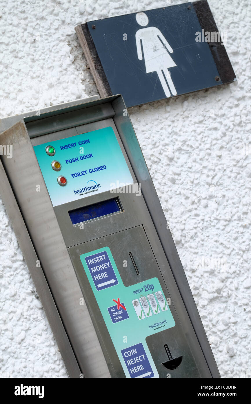 Payment machine to use the toilet outside the public toilets at Bowness on Windermere in the Lake District. - Stock Image