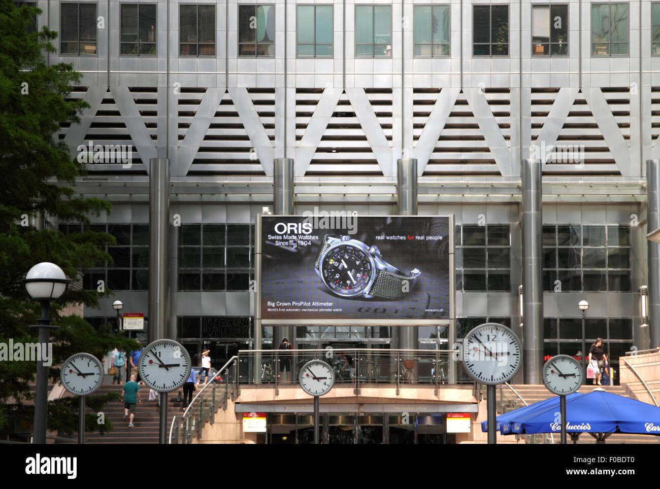Clocks at Reuters Plaza at Canary Wharf London - Stock Image