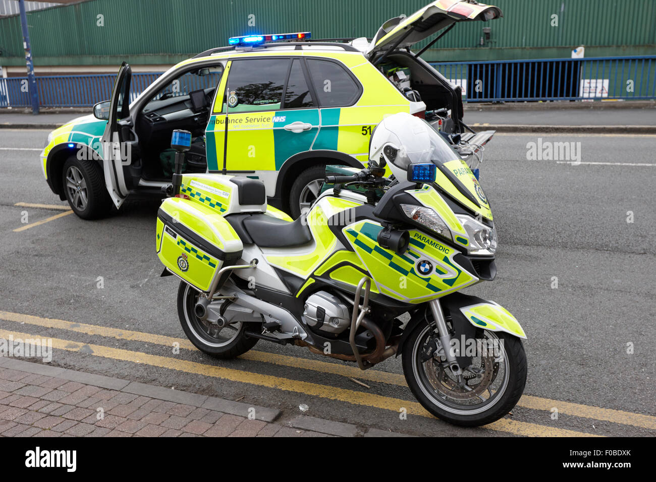 west midlands ambulance service paramedic motorbike and fast response vehicle on a call Birmingham UK - Stock Image