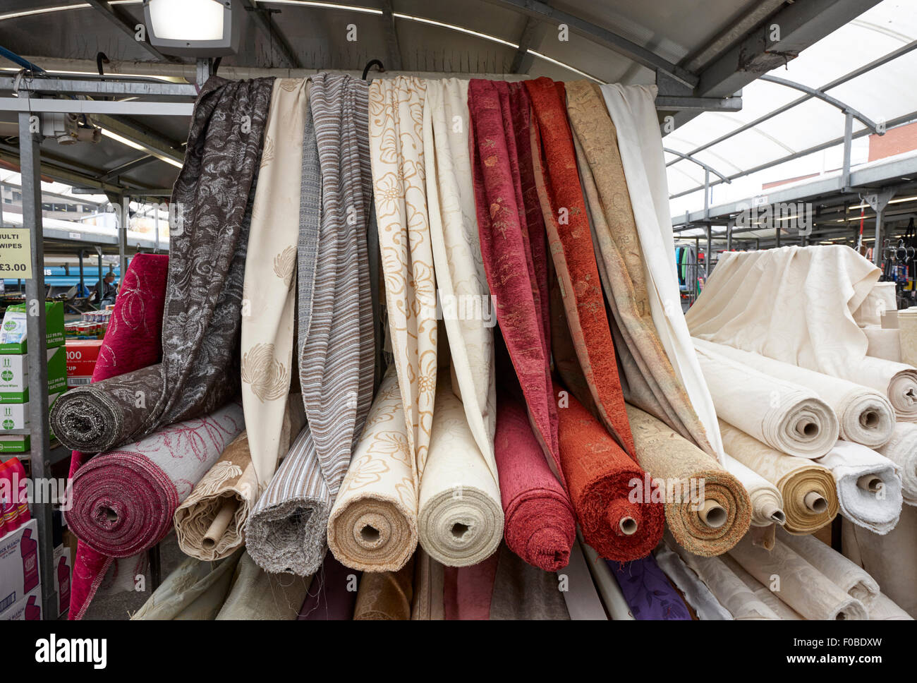 lengths of cloth for sale at an outdoor market Birmingham UK - Stock Image