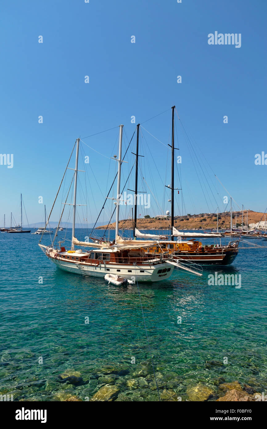 Gulets at anchor on the Aegean coast of Turkey - Stock Image