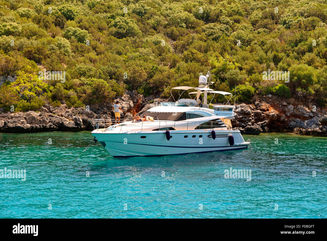Small motor cruiser anchored in the Mediterranean. - Stock Image