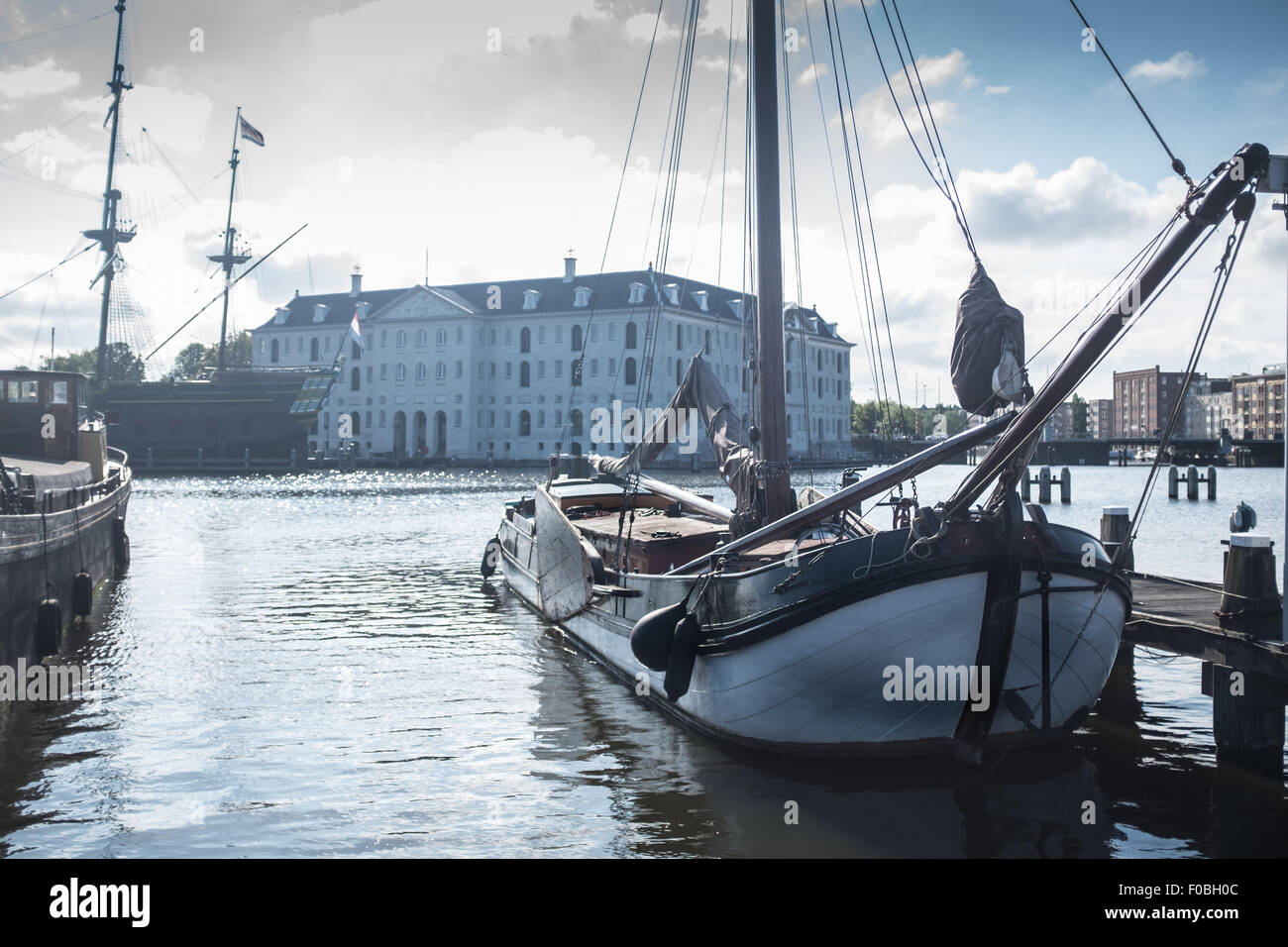 Historic tall ships on the Amstel River in Amsterdam next to the Nemo centre - Stock Image