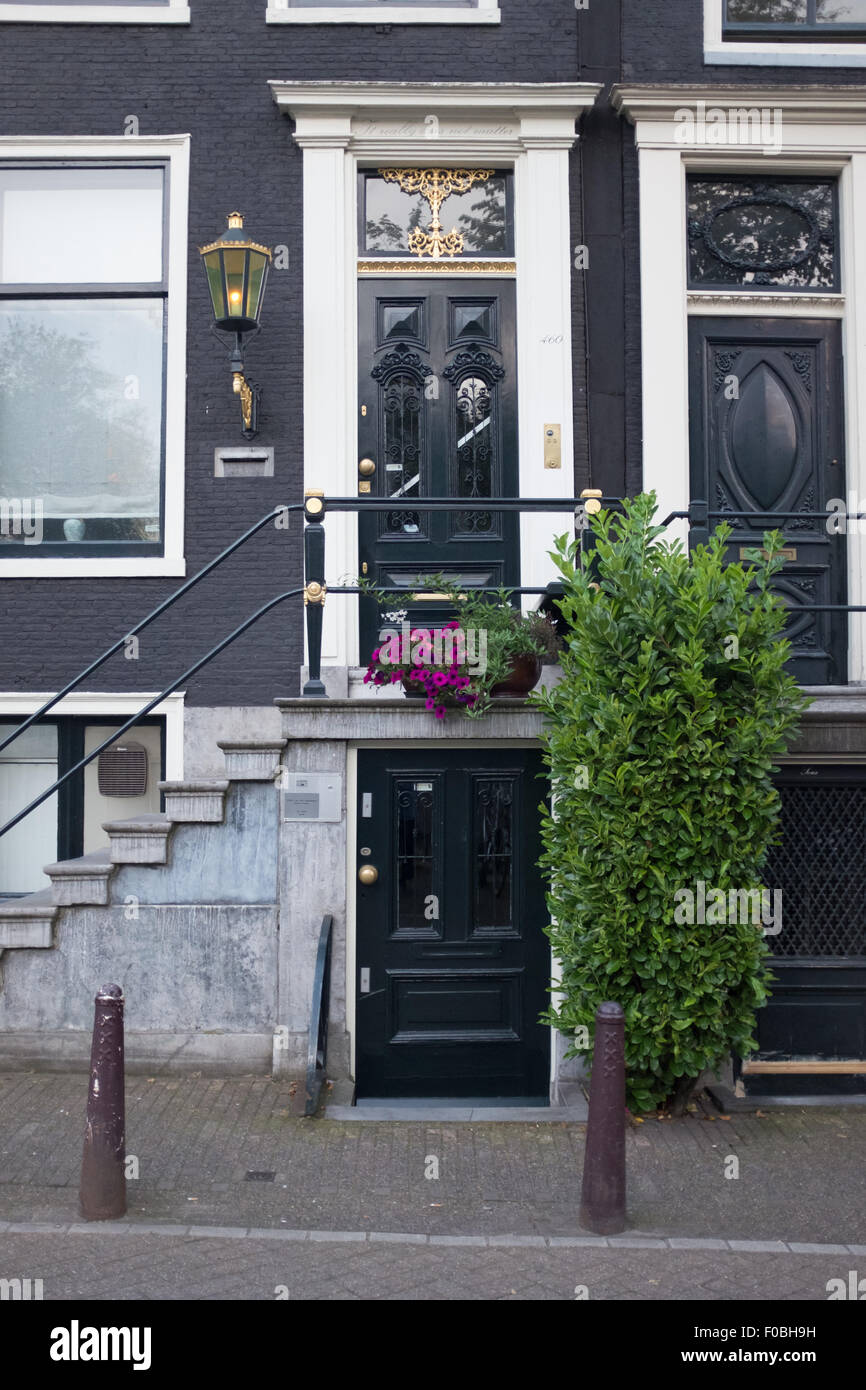 Typical Dutch House Entrance In Central Amsterdam, With Steps Leading To A  Black Front Door