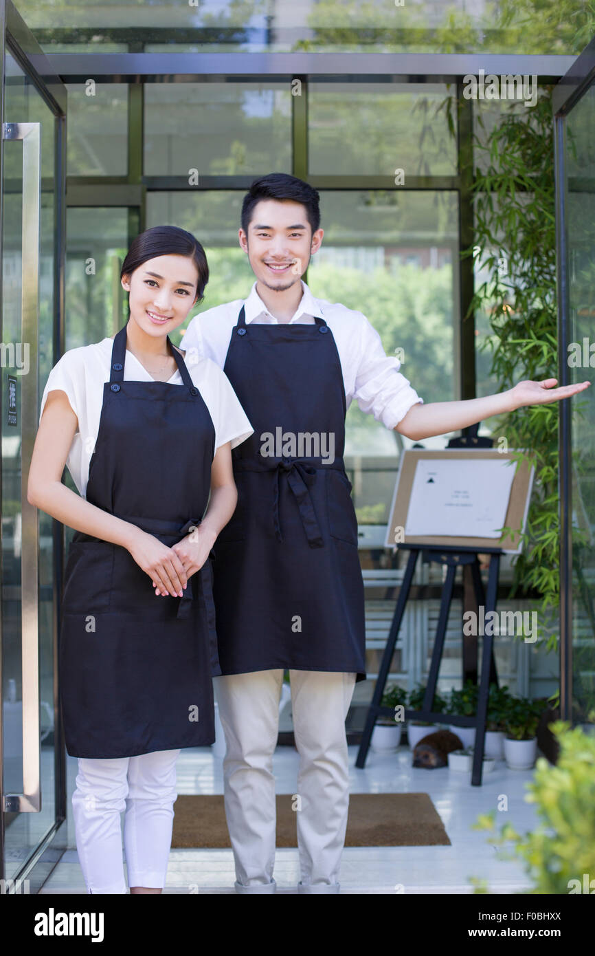 Young couple working in coffee shop Stock Photo