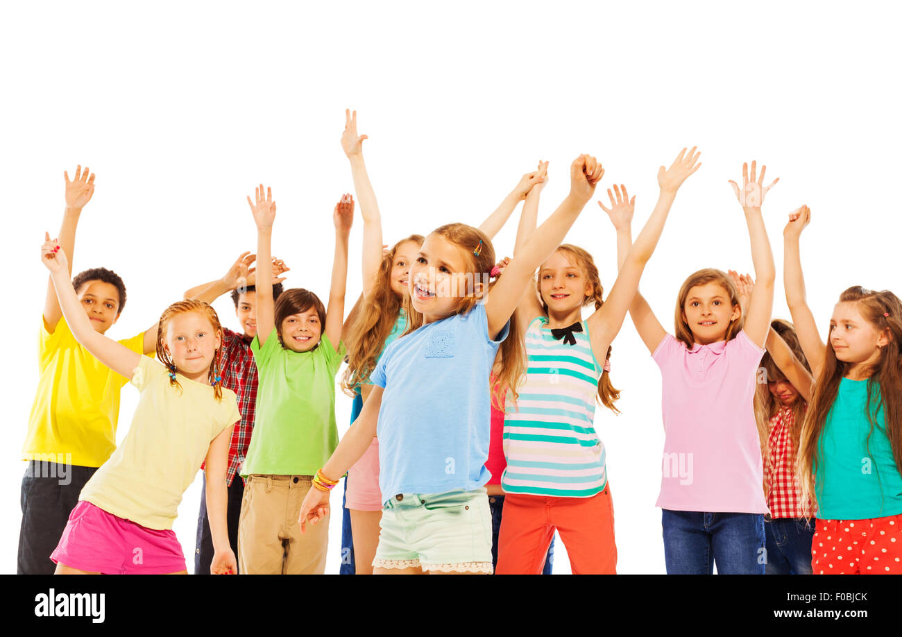 Happy smiling kids rise hands and cheer - Stock Image