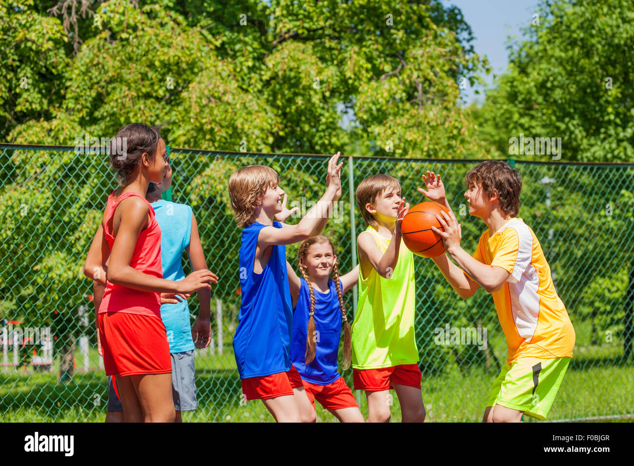 Happy Friends Playing Basketball Game Outside Stock Photo Alamy