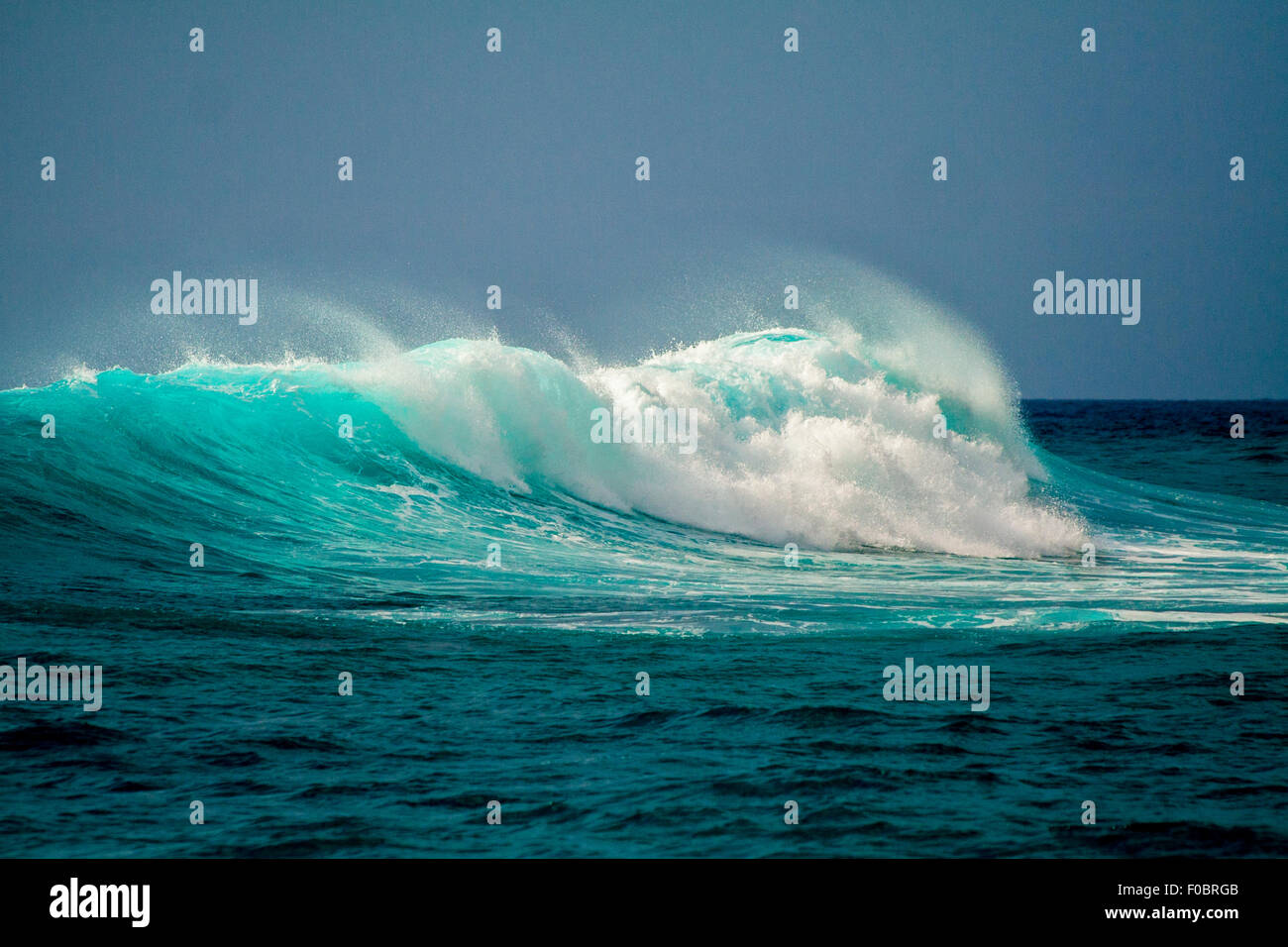 Imposing waves crash against the prevailing wind - Stock Image