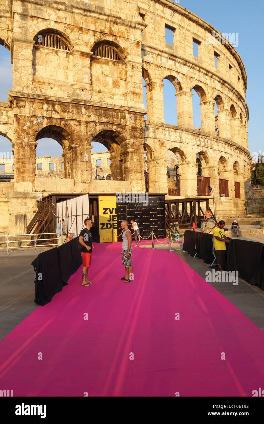 Pula, Croatia. Rolling out the red carpet before the opening of the annual Pula Film Festival in the ancient Roman - Stock Image